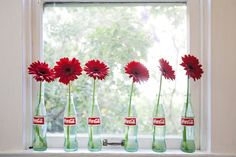 Red Gerbera daisies in classic Coke bottles | Jesica's Mix & Match Studio | Apartment Therapy House Tours