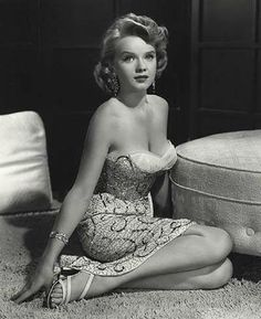 Anne Francis in a seriously sexy, sequined cocktail dress.