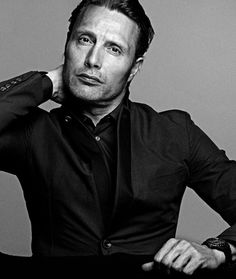 Mads touching his neck