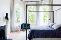 Beautiful bedrooms to inspire an update: A B&B Italia bed from Space Furniture; Ligne Roset 'Ruché' armchair from Domo; Adam Goodrum 'Nest' table from Cult in the bedroom of a revamped Victorian era home in Melbourne's Prahran.