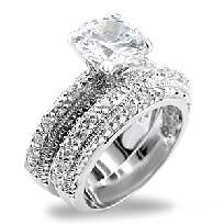2 1/2 Ct. Rhodium Plated CZ Wedding Set, with multiple swarovski crystals around both bands making this an AMAZING RING. A MUST HAVE!