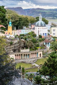 Portmeirion, Wales is just magical with its colorful buildings and eclectic architecture. #portmeirion #wales #uk #architecture