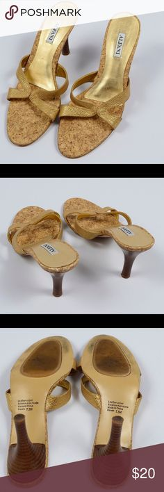 Alfani sandals Gold Alfani sandals with textured straps and cork sole. Leather upper. Three inch heel. Note small area of discoloration on inside of right shoe. Alfani Shoes Sandals