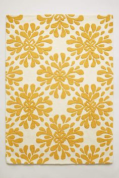 I've loved this rug for years.  Glad they brought the yellow back! Coqo Floral Rug - anthropologie.com