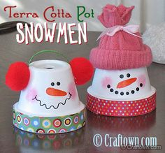 Christmas Decorating Ideas: A little paint, craft paper, and some odds and ends turn terra cotta pots into darling snowmen. The little hat and ear warmers are the perfect touch! Terra Cotta Pot Snowmen Tutorial