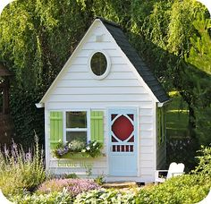 playhouse - love the shudders, blue screen door in front of the red door and the oval window!