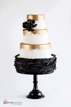 Stunning black white and gold wedding cake.