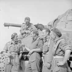 THE POLISH ARMY IN THE NORMANDY CAMPAIGN, 1944 - Sergeant McVay of the Black Watch, 51st Highland Division (second from the left) sharing a joke with soldiers of the 1st Polish Armoured Division before setting off for the attack on the Caen hinge at the beginning of the Operation 'Totalise', 8 August 1944. Sergeant McVay was a resident of Whitby, North Yorkshire.