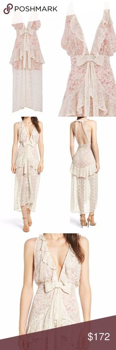 NWT For Love And Lemons Disposition Maxi Dress New with tag For Love and Lemons  The Sweet Disposition Maxi Dress by For Love and Lemons was made to keep your look romantic and dreamy with it's ivory floral embroidery, ruffled double halter neckline, strappy low back with a flattering hip ruffle, and sexy front slit Ivory white cotton blend  Colour: IVORY FLORAL Lining Composition:polyester 100% Outer Composition:cotton 50% Outer Composition:polyester 50% Dry clean only No size tag, care…