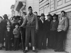 As Japanese immigrants and Japanese-Americans began to be forced to leave their homes, Dorothea Lange captured their journey. The U.S. War Relocation Authority hired the Berkeley-based photojournalist to document the internment in Northern California. Here, a soldier guards those awaiting for transport to a civilian assembly center. San Francisco, April 24, 1942.