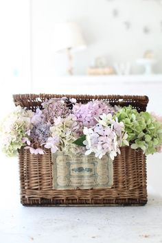 Antique French Basket ... love the flowers ... not too sure about the writing/tag on it ...