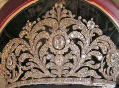 a close up of the central foliate motif of the Duchess of Richmond's tiara, featuring large leaf fronds with a central diamond cluster. This tiara, and many other jewels were stolen from the Richmond Family home of Goodwood House