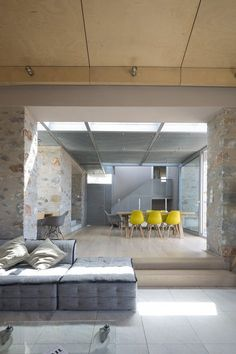 The houses are located on an olive grove in Mani viewing the Messenian bay to the South and the mountain of Taygetos to the North. The complex consists out of six stone blocks placed in between the existing olive trees. The positioning of the stone...