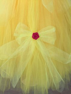 This Princess Belle dress will be the hit of any celebration. Not like any costume that you would find in a store. It is super poofy. She will feel like a Princess and twirl everywhere. The yellow crochet top is lined, making it soft and not see-through! The dress is made with golden yellow