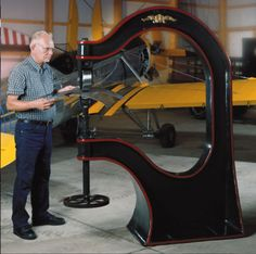 """The MetalAce Imperial Line, also known by the name Right Angle Tool Div, feature cast ductile iron frames that provide sturdy vibration free units with the rigidity you expect from a cast frame. The machines come in 44"""" and 28"""" throat sizes. Each machine is painted with a hammer tone finish with hand pinstriped accents. These machines fit the needs of the most discriminating metal shaper."""