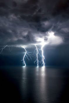 Lightning caresses the ocean