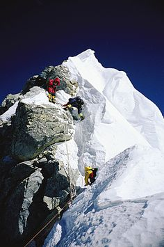 Mountaineers navigating through the Hillary Step on Mount Everest. The Hillary…