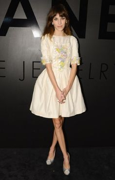 Alexa Chung's dainty cream dress may come courtesy of Chanel's 2013 Resort collection, but the high street is littered with embroidered and embellished pieces. Imagine this dress without the detailing? Exactly.