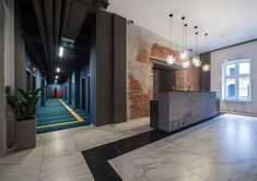 """The hotel's interior has been designed by the """"EC-5″ studio. The interiors reflect the spirit of the 50s and 60s. The dominant colours, both in hotel rooms and communal areas, are steel gray and vivid blue, violet and green."""