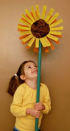 Crafting with Recyclables – Giant Sunflower made with oatmeal containers and broom stick (what a fun photo prop!)