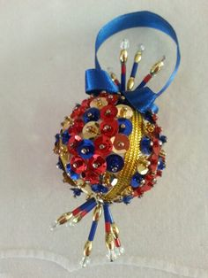 Beaded and sequined bauble.   Made by residents at RLR old age home