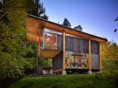 On Puget Sound, activist and filmmaker Anna Hoover collaborated with Les Eerkes, a principal at Olson Kundig Architects, on a 693-square-foot studio in the woods. Using freecycled materials and a six-footed foundation to rein in construction costs, Hoover and Eerkes created a distinctive structure that treads lightly on the land.