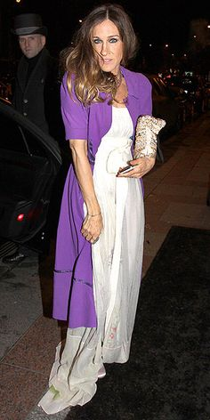 in a Louis Vuitton floral gown topped with an amethyst car coat and champagne accessories.