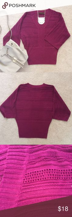 The Limited Dolman Sleeve Wine Colored Sweater Gorgeous color and cut! Wear this sweater with your favorite jeans and you are ready for your day. This sweater has loose fitting dolman sleeves and a fitted waist. It is made of 100% acrylic and measures 25 inches from shoulder to hem. The Limited Sweaters V-Necks