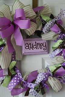 Lots of fun ribbon wreaths- good for baby shower/ baby nursery!