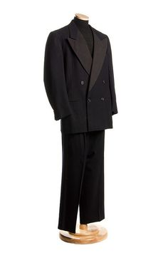 Man's black wool formal suit, c. 1950. The label in the coat is Griffan Clothes / Tailored for Jack Krawcheck / Charleston. It was worn by Judge Clarence Benjamin Pearce (1897-1984), Charleston Family Court judge for 23 years. Jack Krawcheck Company was a fine men's store founded in 1922 by Jack E. Krawcheck (1899-1986), a Polish immigrant who created a men's clothing store in Charleston that became a fashion icon. Charleston Museum.