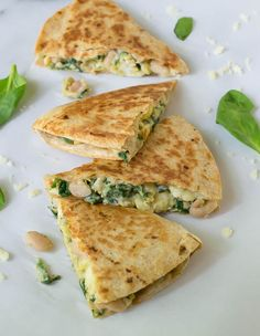 Healthy breakfast quesadilla recipe with cheese, spinach, and white beans. Freezer friendly so you can make these ahead too!