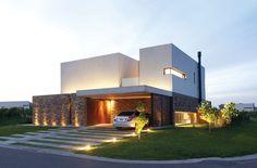 GMARQ Govetto Mansilla Arquitectos - Casa estilo actual - PortaldeArquitectos.com