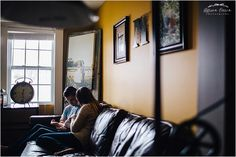 Lifestyle. Newborn. photo of mom and dad holding new baby on couch by Allison Corrin