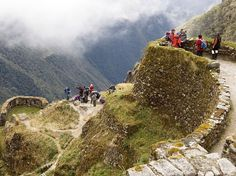 Many visitors to Machu Picchu choose to get there the way the ancient Inca did—on foot. The legendary Inca Trail winds through Peru's Andes Mountains and along the path of the ancient royal highway. More than 75,000 people make the trek each year. Photograph by Camera Press/Redux, December 11, 2014