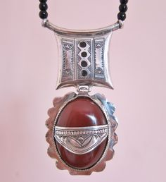 Tuareg Amulet with Carnelean Stone, Pure Silver & Onyx Beads Necklace by TuaregJewelry on Etsy https://www.etsy.com/ca/listing/203949918/tuareg-amulet-with-carnelean-stone-pure