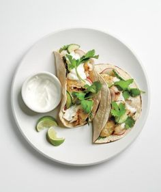 Tilapia Tacos with Cucumber Relish: Skip the local Mexican joint and prepare this fresher, healthier version of the classic at home. Grilling the fish rather than frying it adds bold taste without all the fat. Wrap the cooked tilapia in soft corn tortillas, top each of the tacos with a crunchy radish and cucumber relish, and serve with your favorite accompaniments (cilantro, sour cream, and lime wedges are a must!).