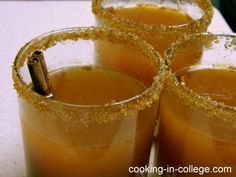 Hot Caramel Apple Cider for grown ups! 4 cups apple cider; 1 cup Smirnoff Kissed Caramel vodka; 1 TBSP cinnamon; 1/4 cup brown sugar: Mix ingredients in a large pot. Heat over medium-low heat, stirring occasionally until liquid just begins to steam (don't over heat or alcohol will burn off). Rim glasses with brown sugar. Serve with cinnamon stick stirrer. (4 servings)