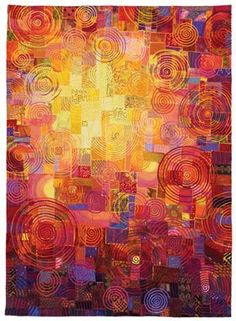 Carol Taylor's fabulous Circle quilt positively glows. This was pictured on Quilting Daily.