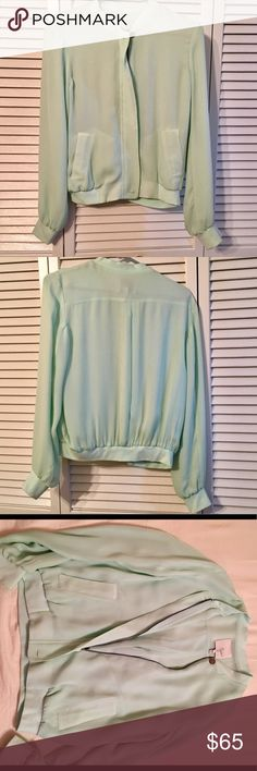 Joie Zip Up Seafoam Top A classic Joie staple that's perfect for you to style up anyway you want- wear it as a light jacket or a top over your favorite bralette. The options are endless! In excellent pre loved condition, worn only twice! Joie Tops Blouses