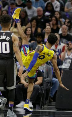 Golden State Warriors guard Patrick McCaw, right, falls to the court following a Flagrant 1 foul by Sacramento Kings's Vince Carter in an NBA basketball game Saturday, March 31, 2018, in Sacramento, Calif. McCaw was taken off the court on a stretcher. The Warriors won 112-96. (AP Photo/Rich Pedroncelli)