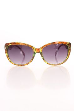 Here comes the fun, adorably cute and all around perfect, these trendy chic sunglasses will protect your delicate eyes from harmful sun rays, or just wear them strictly for their cute factor! Boasting beautiful color side arm detailing, multi print translucent cat eye frame sunglasses complete with ombre tinted lens.