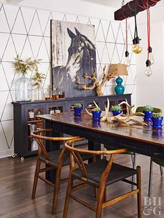 For a dose of pattern, a black-on-white geometric design was added to a dining room wall. The motif was drawn with a yardstick and pencil, then the lines were traced over with black paint using a small brush. The dining room chandelier was built by the homeowners: The couple threaded the cords of five light sockets through a salvaged board and hung it by a chain.