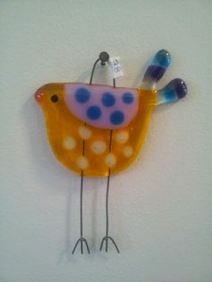Fused glass bird.