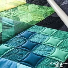Peacock feathers are created with free motion quilting. See more of this quilt and learn how here: https://kathleenquilts.com/2016/03/11/free-motion-friday-peacock-feather/
