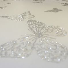 Butterfly glitter wallpaper from our exclusive glitter range combines an embosed glitter butterfly onto a high quality luxury paper creating a sparkling textured effect on your wall. This wallpaper is perfect for creating a shimmering glitter feature wall.