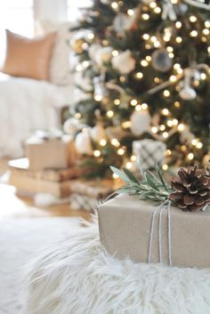 Cozy + Sentimental Christmas Tree-City Farmhouse.Simple wrapping ideas with craft paper, yarn and rosemary & olive branches