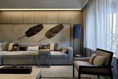 Living Room - Modern elegance in muted tones with visual with great impact back wall.  (re-pinned photo - Wan Interiors)