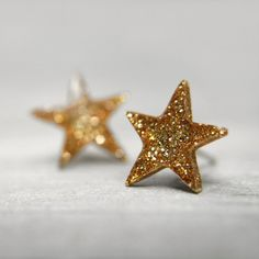 star post earrings in sparkly gold by tinygalaxies on Etsy, $20.00