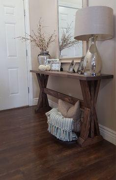 Rustic farmhouse entryway table. If you like this pin, why not head on over to get similar inspiration and join our FREE home design resource library at www.FlorenceAndFreya.com?