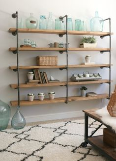 DIY Industrial Pipe Shelves are an easy weekend project that require no special skills. Here is a budget-friendly step-by-step guide to make your own. #pipeshelf #diyshelf #diypipeshelf #diyhomeproject #thedesigntwins